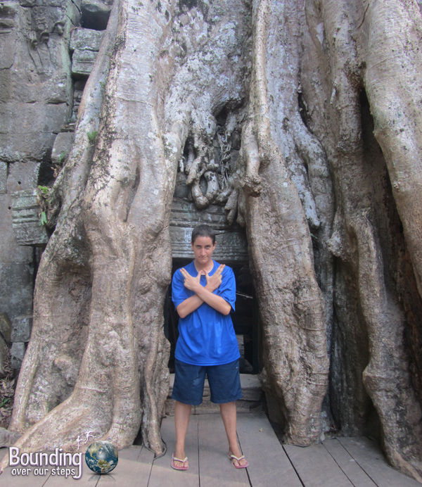 Mindy impersonating Angelina Jolie's Tomb Raider at Ta Prohm Temple in Angkor Wat, Cambodia