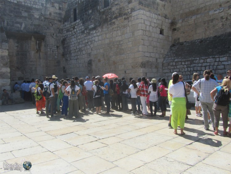 Long line of visitors waiting to visit the Church of Nativity in Bethlehem, Palestine