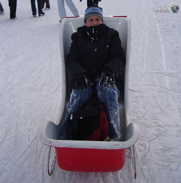 Ligeia in the sleigh on the Rideau Canal with injured knees