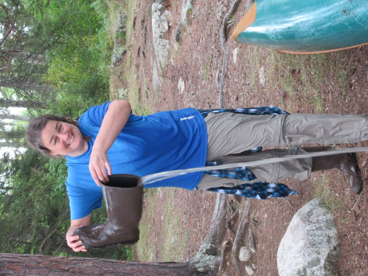 Emptying the water from my boots after tipping the canoe in the Boundary Waters Canoe Area (BWCA)