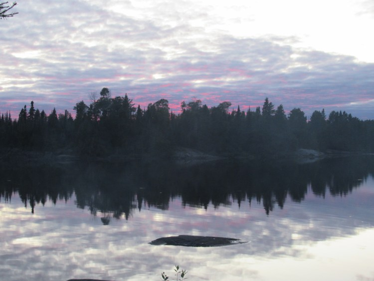 A bright pink sunset in the Boundary Waters Canoe Area (BWCA)