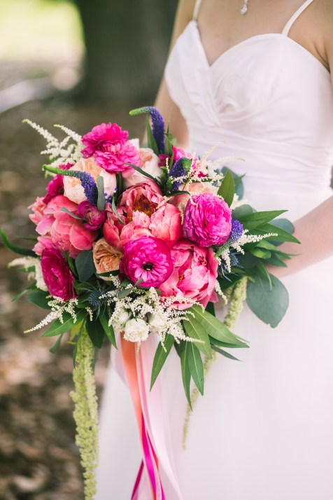 Coral peony, hot pink ranunucla and garden roses.