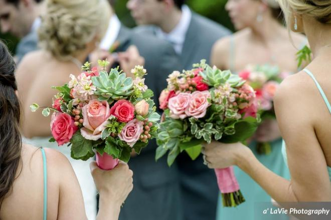 Bouquets with succulents with soft shades of corals.