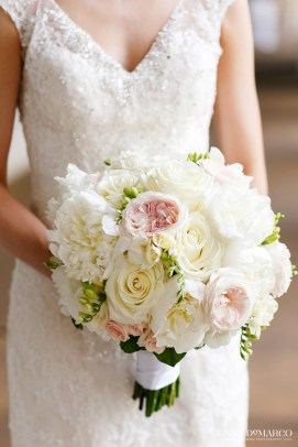 Blush garden roses and white peony in a traditional bridal bouquet.