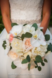Classic bouquet of phaelonopsis orchids,juliiette garden roses and peony.