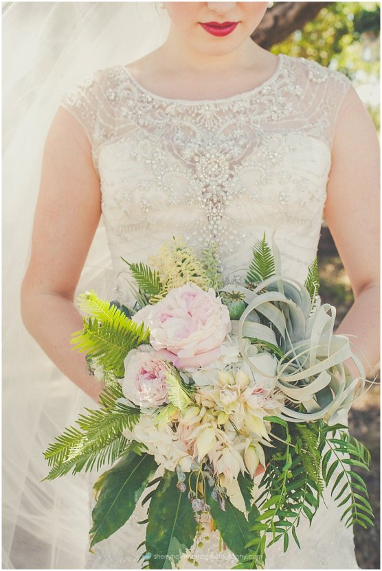 Modern bridal bouquet with pastel garden roses and tillandsia.