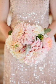 Pastel bridesmaid bouquet featuring cafe au lait dahlia, garden roses, and ivory roses.