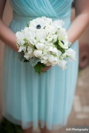 Bridesmaid bouquet with anemone and seasonal winter flowers.