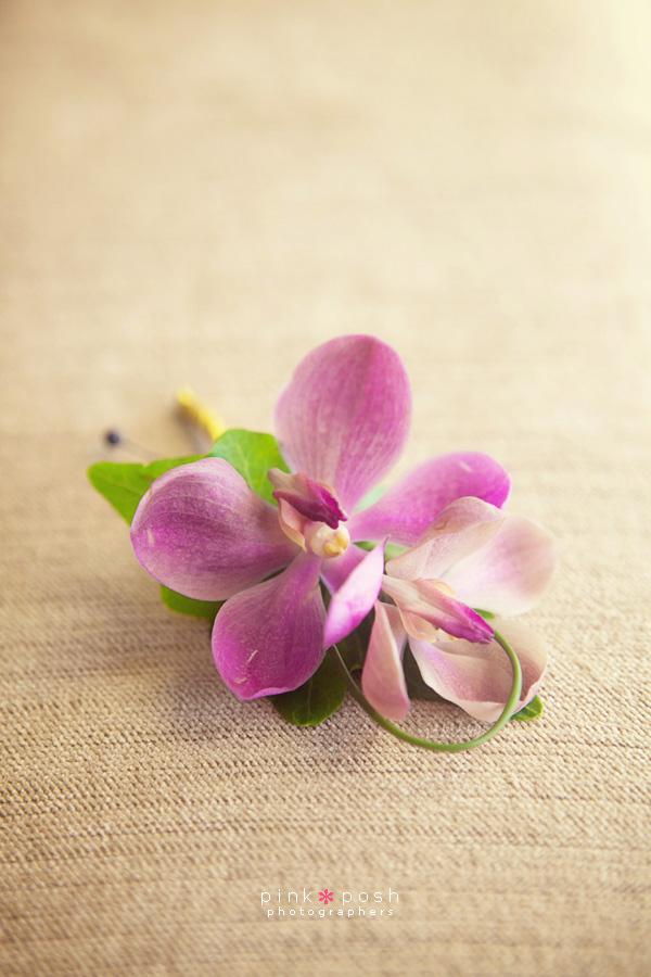 Purple mokara orchid bouttoniere