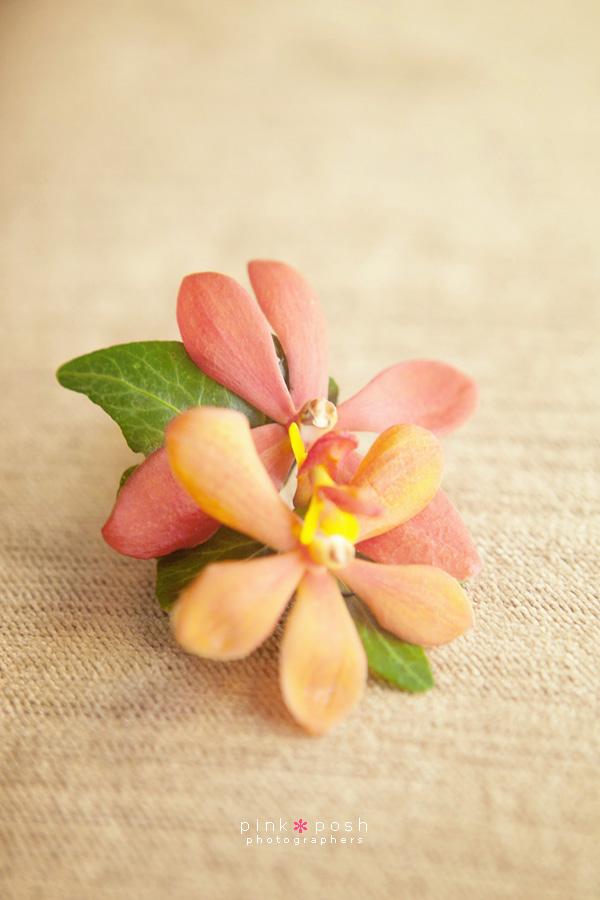 Gold mokara orchid bouttoniere