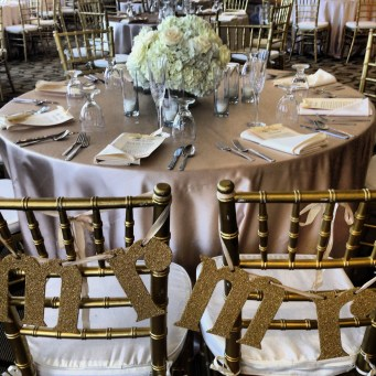 Adding a little sparkle for the bride and groom chairs.