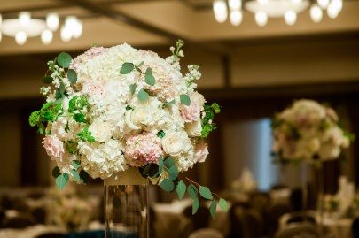 Perched atop a 31 inch cylinder the collection of flowers included hydrangeas, roses, viburnum stock.