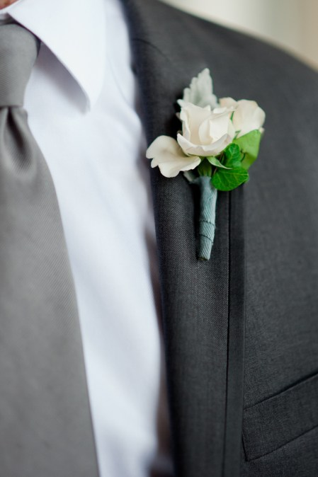 Ribbon accented spray roses for the wedding party.