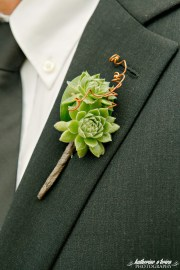 Succulent boutonniere for groom.
