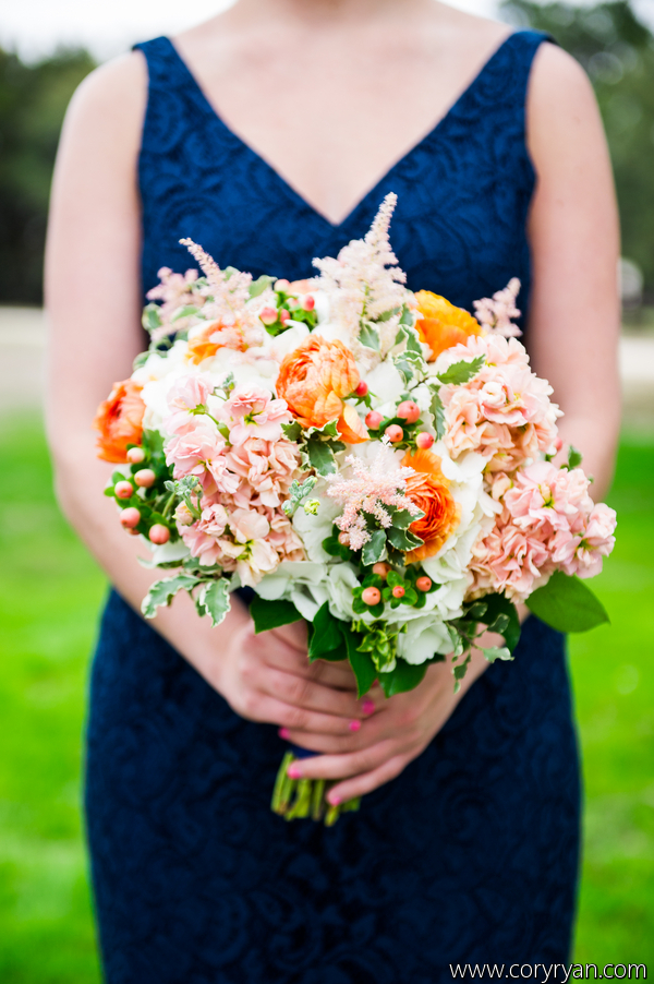 Soft, tones of peaches with a pop of orange for the bridesmaids.