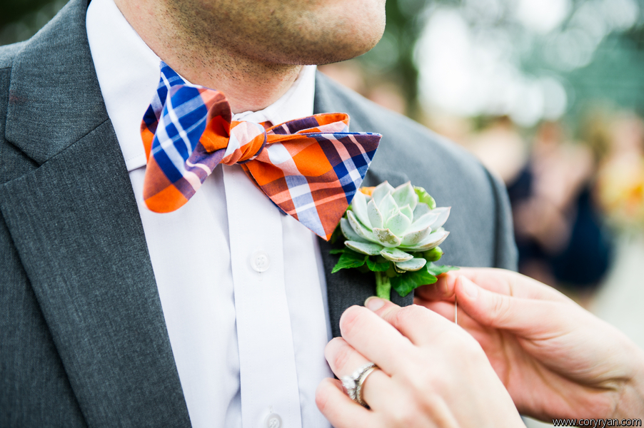 Succulent bouttoniere to complement an adorable bow tie.