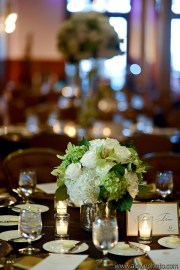 White roses, hydrangea accented with green orchids and hydrangea.
