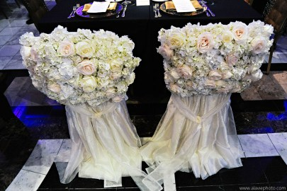 Bride and Groom chair covers with fresh flowers.