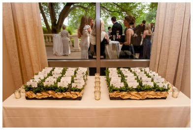 Escort card display of boxwood and gold leaf accents