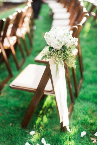 Chair marker for outdoor ceremony.