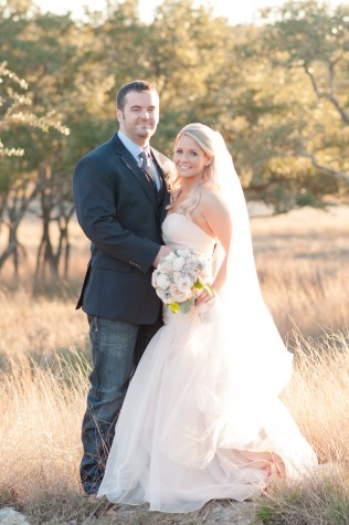 Winter bride and groom with blush and pastel flowers.