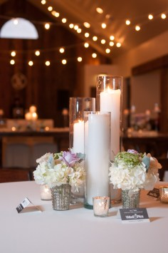 Trio of candles for wedding reception.
