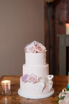 Soft pink and lavender roses for cake decor.