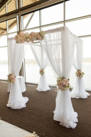 White canopy for indoor wedding ceremony.