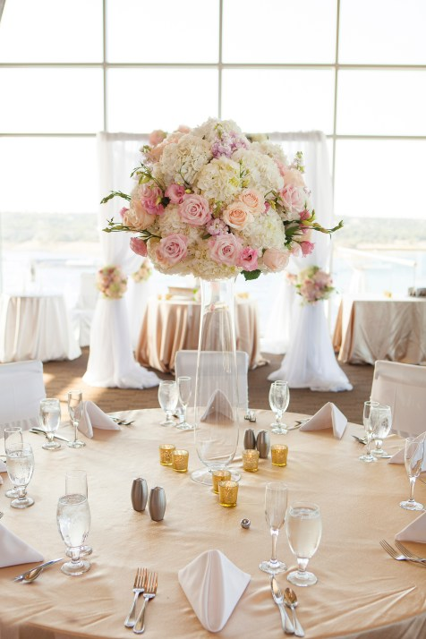 Tall elevated centerpiece for wedding reception