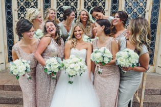 Blush bridesmaids gown in sequins with white bouquets.