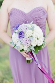 Bridesmaids bouquet of white, lavender and purple flowers.