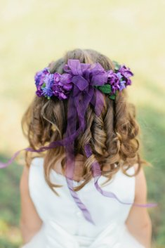 Shades of purple blooms on flower crown for flower girl.