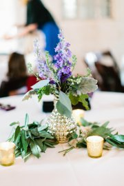 Gold mercury glass centerpiece with purple summer blooms