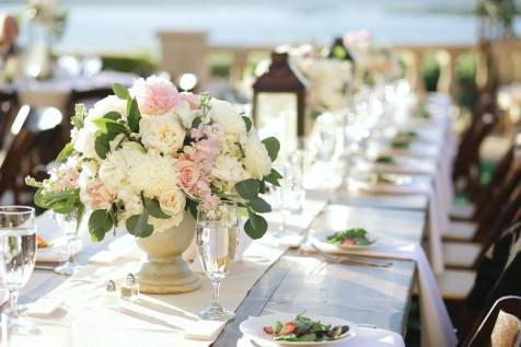 Vineyard dining tables for an outdoor reception.