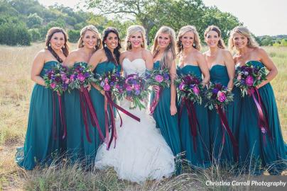 teal bridesmaids gowns with fall flowers