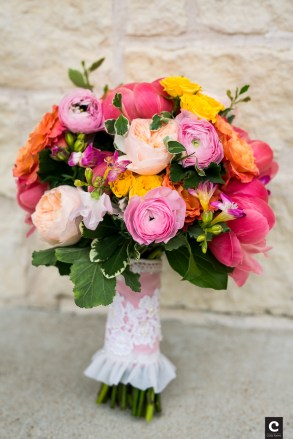Coral Peony Orange Roses And Pink Ranunculi In A Bridal Bouquet