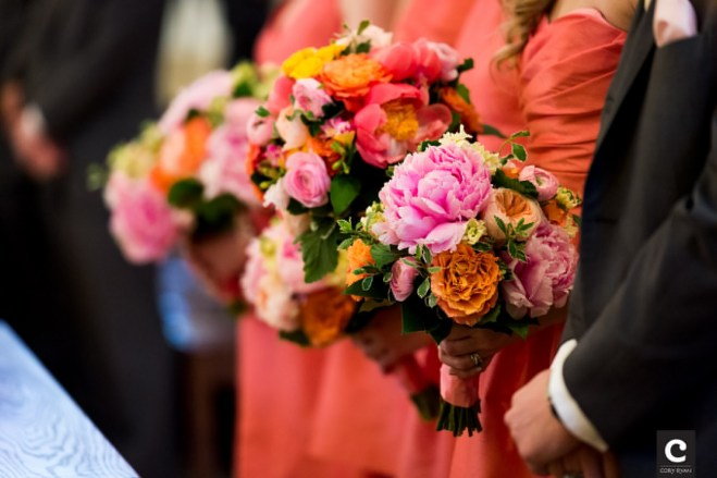 Multicolored bridesmaids bouquets to complement pink gowns.