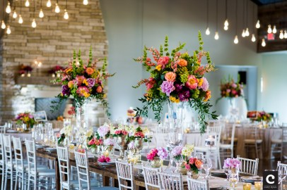 Wedding reception at Canyonwood Ridge with tall centerpieces.
