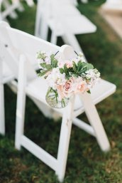 Hanging hobnail jar with blush blooms for outdoor ceremony.