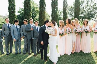 Bridal party with blush blooms- mix and match blush gowns.