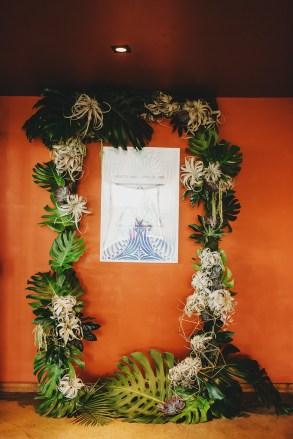 Tropical leaf frame at wedding ceremony.