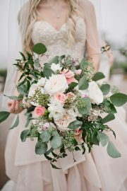 Brides bouquet of silver dollar eucalyptus and blush flowers.