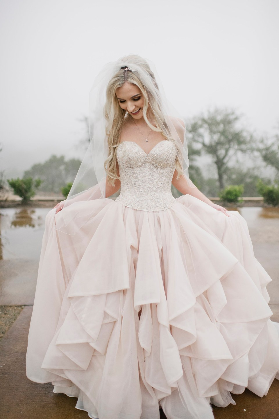 Bride in blush wedding gown