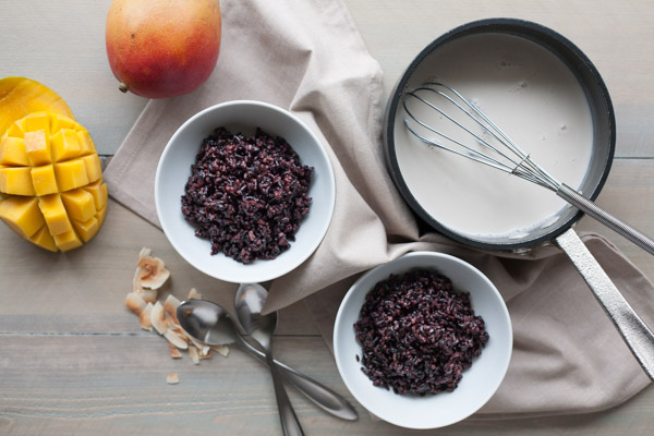 Black Rice Pudding with Coconut and Mango | BourbonandHoney.com Square -- Warm, comforting and delicious, this Black Rice Pudding with Coconut and Mango is perfect for breakfast, a snack or even dessert!