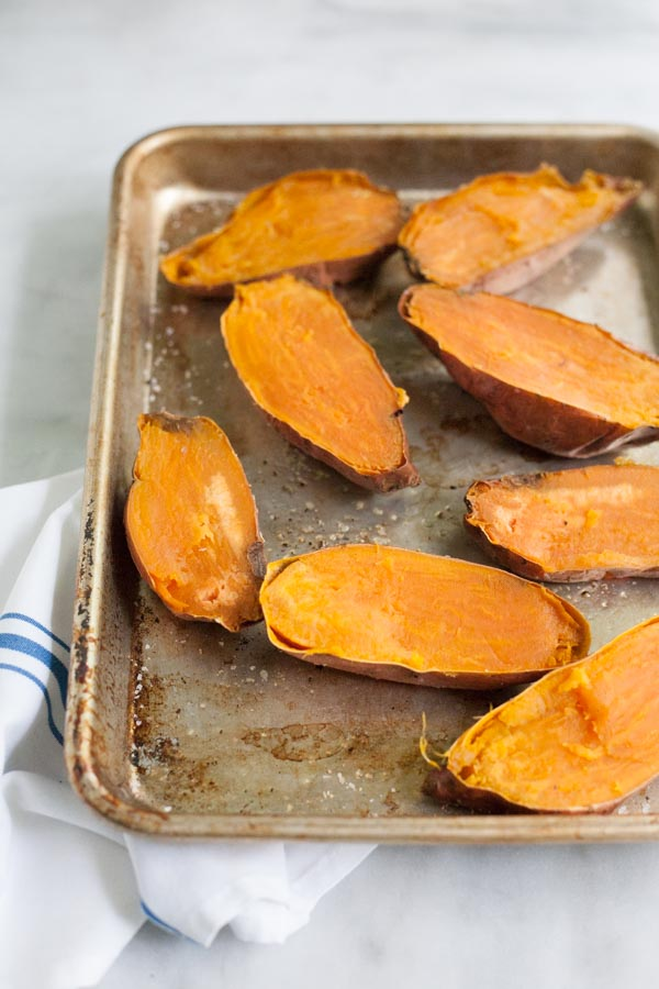 Greek Baked Sweet Potatoes   BourbonandHoney.com -- These simple Greek Baked Sweet Potatoes are a hearty, healthy and flavorful weeknight recipe or a great brown bag lunch.