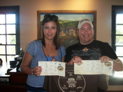 Seth and Amber Harrison of Iowa proudly display their completed Kentucky Bourbon Trail Passports at their last stop, Woodford Reserve Distillery in Versailles, Kentucky