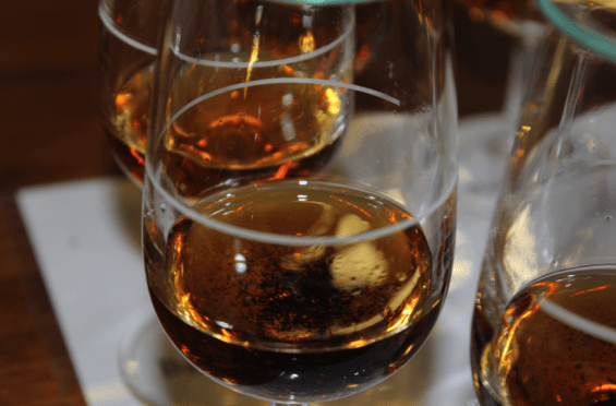 Tasting Glass of Fine Bourbon Whiskey thieved fresh from the barrel, non-charcoal filtered