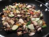 Chopped veggies being sauteed