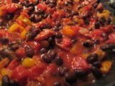 Chopped color peppers with sausage, black beans, and diced tomatoes