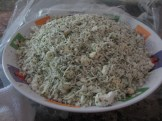 Cheeses mixed with parsley in a bowl